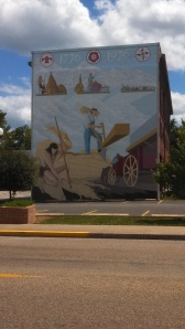 Mural of indian & settler on the side of a building in Mascoutah